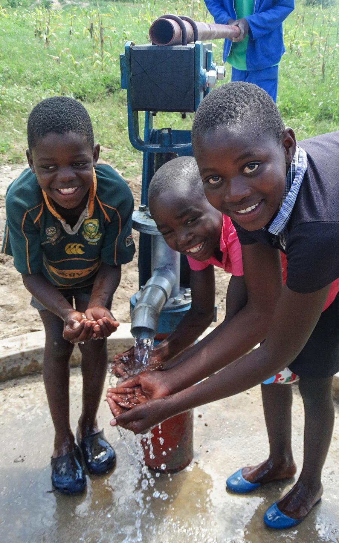 Boys at borehole