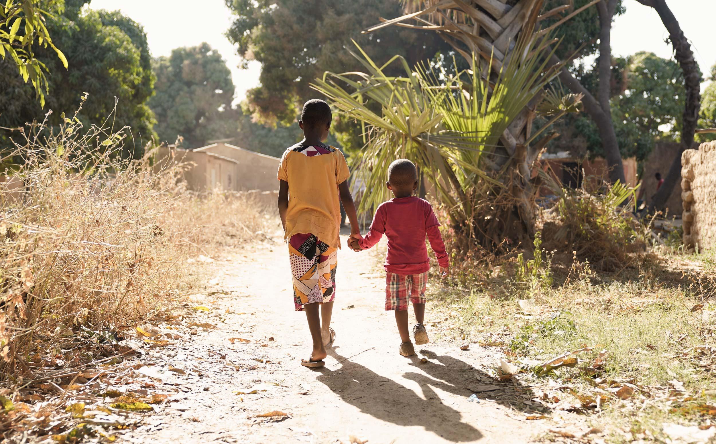 Boys walking holding hands